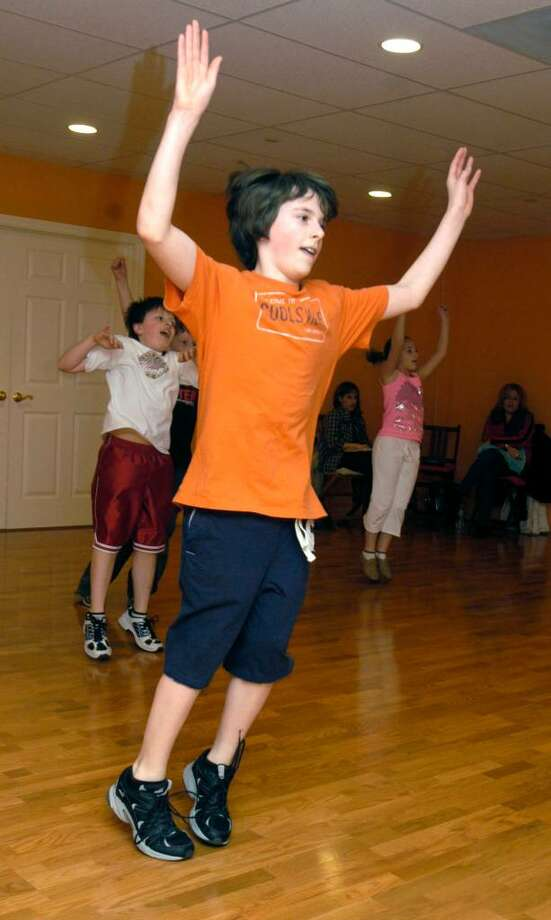 "Zane Lynch, 12, of Newtown particiaptes in a ""Zoom"" exercise class at the Fred Astaire Studio in Brookfield Friday, January 29, 2010. Photo: Carol Kaliff / The News-Times"