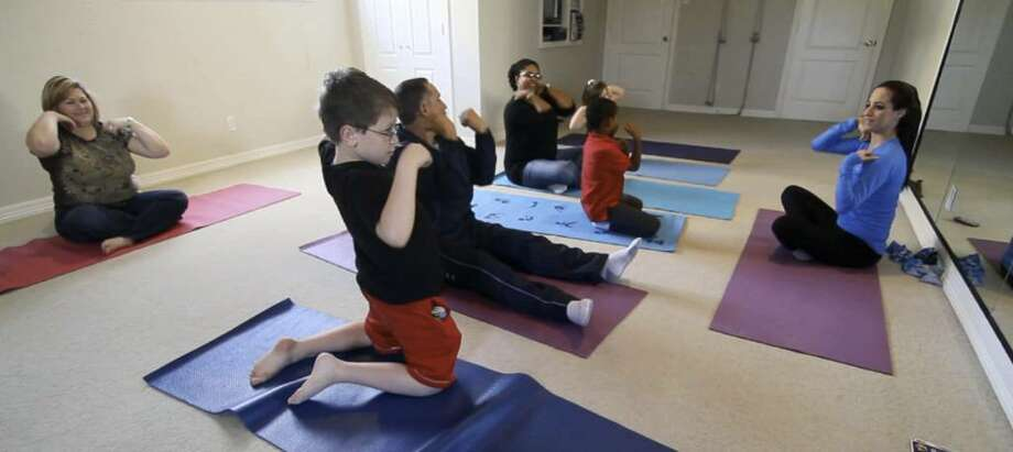 In this video frame grab, Lynne Silberman, far right, teaches her yoga class to special needs children and their parents, November 23, 2009, in Dallas, Texas. The class meets twice a week. (Ron Baselice/Dallas Morning News/MCT) Photo: RON BASELICE, MCT / Dallas Morning News