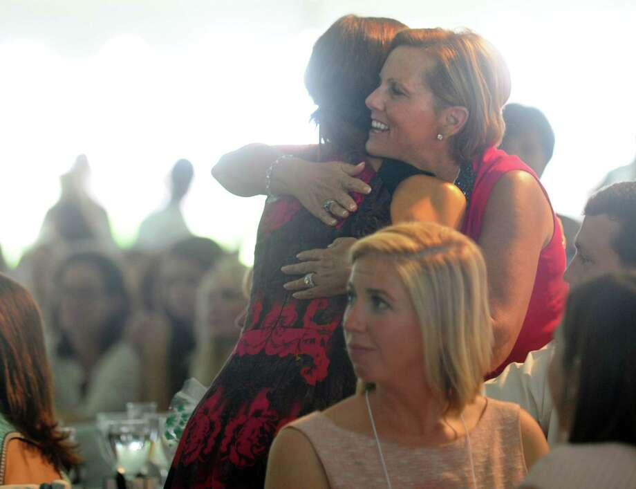 Patti Keegan hugs keynote speaker Giuliana Rancic during the Rose of Hope luncheon Friday, June 13, 2014, at Keegan's home in Fairfield, Conn. Photo: Autumn Driscoll / Connecticut Post