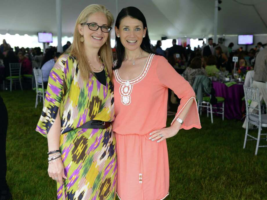 Mindy Hersh, of Fairfield, and Bonnie Marcus, of Westport, pose in pastels during the Rose of Hope luncheon Friday, June 13, 2014, at the home of Patti and Tom Keegan in Fairfield, Conn. Photo: Autumn Driscoll / Connecticut Post