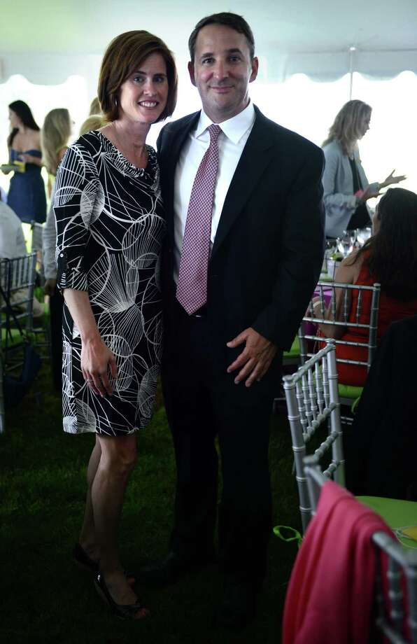 Christina and Kyle Miller, of Trumbull, show off their style sense during the Rose of Hope luncheon Friday, June 13, 2014, at the home of Patti and Tom Keegan in Fairfield, Conn. Photo: Autumn Driscoll / Connecticut Post