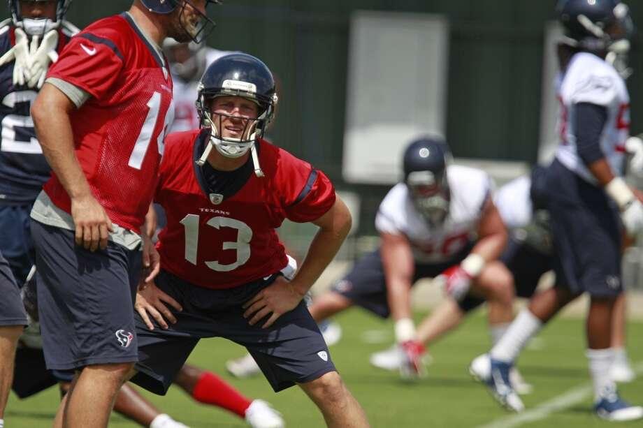 T.J. Yates (13) stretches. Photo: Melissa Phillip, Houston Chronicle