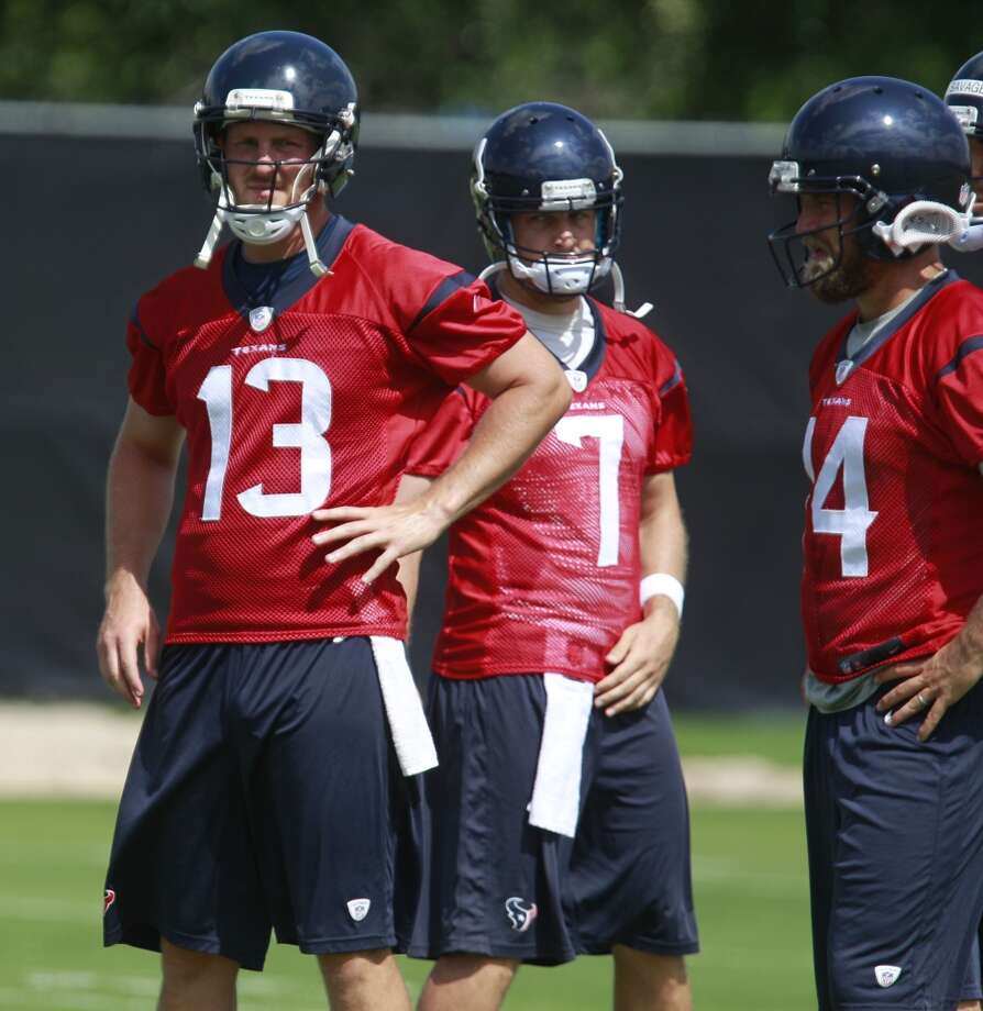 T.J. Yates (13) Case Keenum (7) and Ryan Fitzpatrick (14) wait between drills. Photo: Melissa Phillip, Houston Chronicle