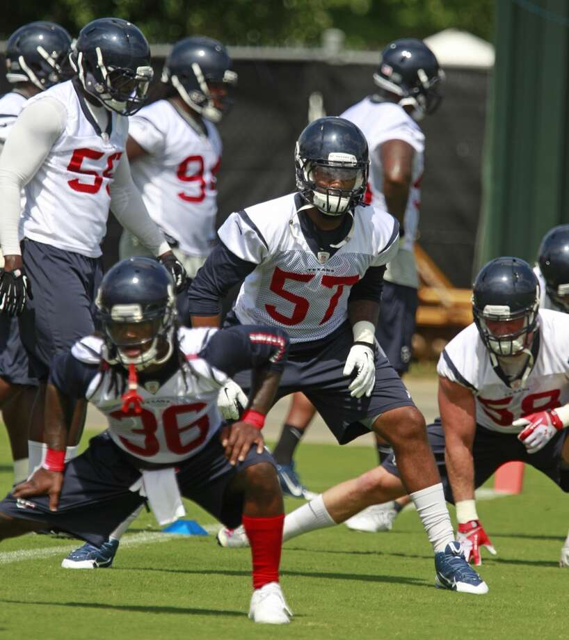 D.J. Swearinger (36), Justin Tuggle (57) and Brooks Reed (58) stretch with their teammates. Photo: Melissa Phillip, Houston Chronicle