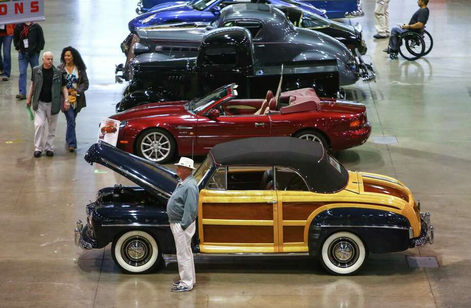 Cars are shown during the Mecum rare and collector car auction at CenturyLink Field Events Center as potential bidders browse the rows. Photo: JOSHUA TRUJILLO, SEATTLEPI.COM / SEATTLEPI.COM