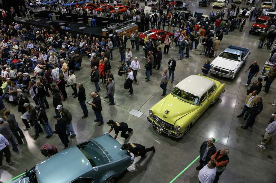Cars are are moved into position during the Mecum rare and collector car auction. Photo: JOSHUA TRUJILLO, SEATTLEPI.COM / SEATTLEPI.COM
