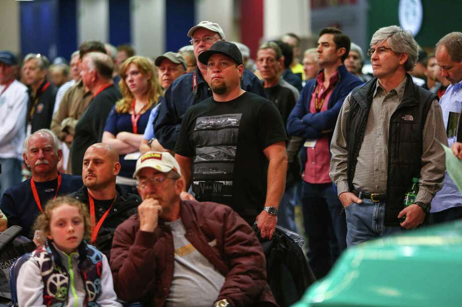 People watch the action during the Mecum rare and collector car auction. Photo: JOSHUA TRUJILLO, SEATTLEPI.COM / SEATTLEPI.COM