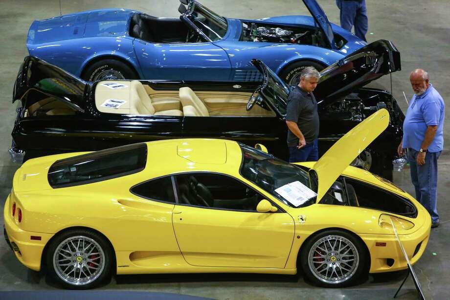 A 2002 Ferrari Modena is shown, foreground, during the Mecum rare and collector car auction Photo: JOSHUA TRUJILLO, SEATTLEPI.COM / SEATTLEPI.COM