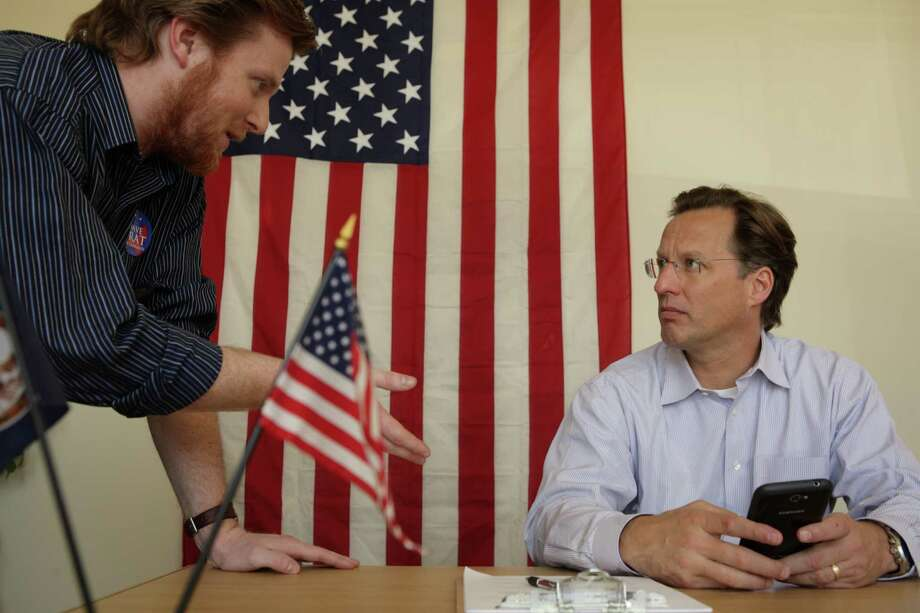 College professor and GOP candidate for Congress David Brat, right, had only two paid staffers - one being his campaign manager, Zach Werrell, left - before his surprise win over House Majority Leader Eric Cantor in last week's primary. Since then, Brat has largely been holed up inside his suburban Richmond, Va., home. Photo: Jay Paul, Stringer / 2014 Getty Images
