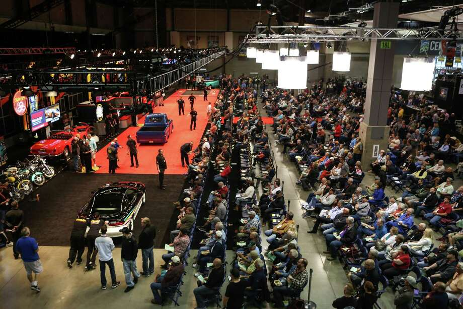 People place bids on a car during the Mecum rare and collector car auction at CenturyLink Field Events Center. Photo: JOSHUA TRUJILLO, SEATTLEPI.COM / SEATTLEPI.COM