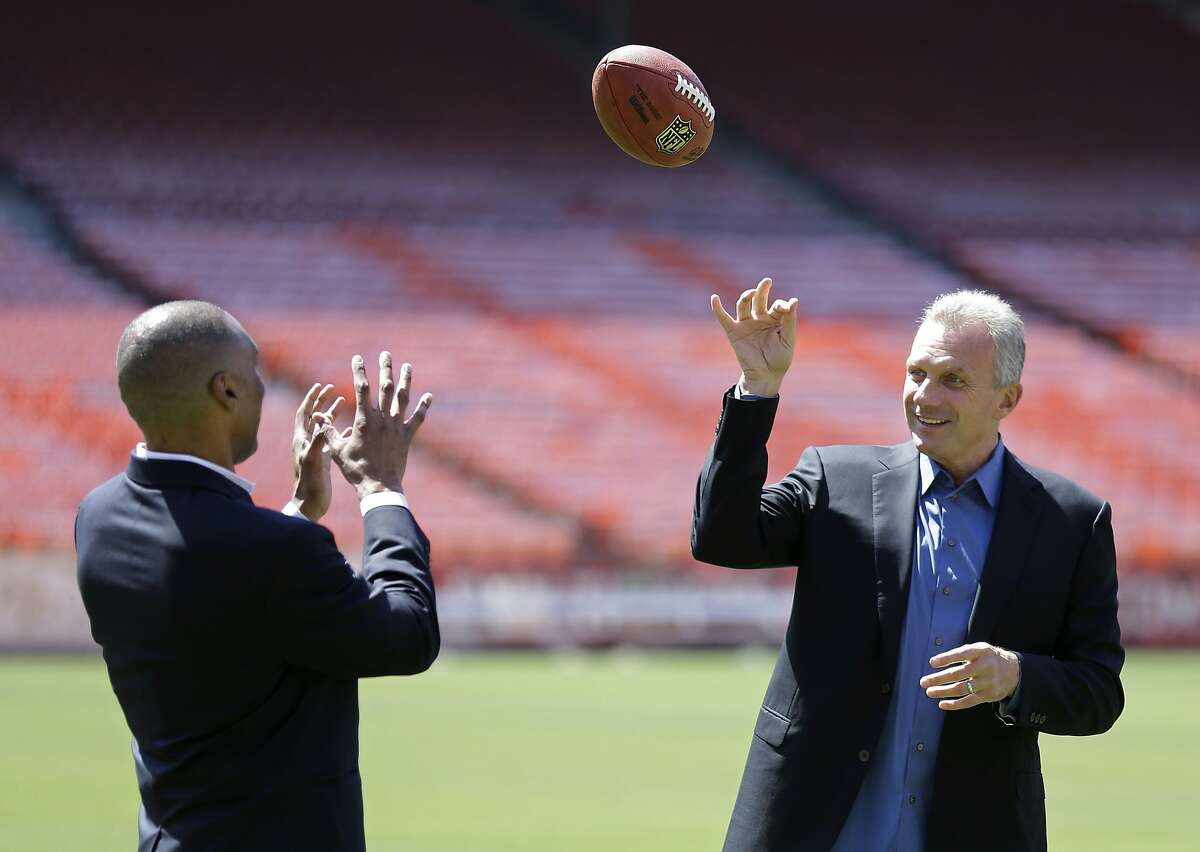San Francisco 49ers Hall of Fame quarterback Joe Montana, right, tosses a football with retired running back Roger Craig, left, during a photo shoot at Candlestick Park before a news conference about their upcoming flag football game Wednesday, June 4, 2014, in San Francisco.