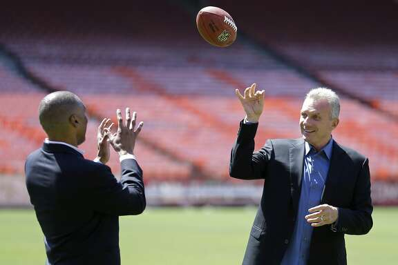 "San Francisco 49ers Hall of Fame quarterback Joe Montana, right, tosses a football with retired running back Roger Craig, left, during a photo shoot at Candlestick Park before a news conference about their upcoming flag football game Wednesday, June 4, 2014, in San Francisco. ""Legends of Candlestick,"" will be the final football game to be played at Candlestick Park on July 12 when Montana, Craig, Jerry Rice, Steve Young, Dwight Clark and other 49er teammates play a flag football game against a team of NFL stars captained by Hall of Famer Dan Marino. (AP Photo/Eric Risberg)"