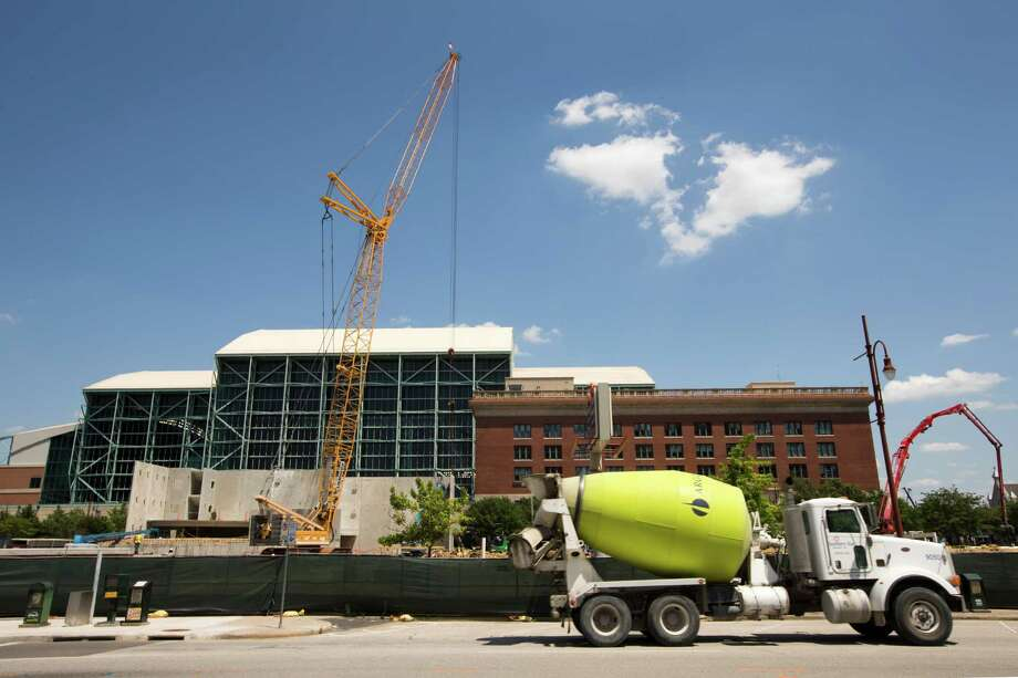 An apartment complex goes up this month near Minute Maid Park. Apartment developer Martin Fein told real estate journalists last week that Houston's job creation rate means there's room for more construction. Photo: Brett Coomer, Staff / © 2014 Houston Chronicle