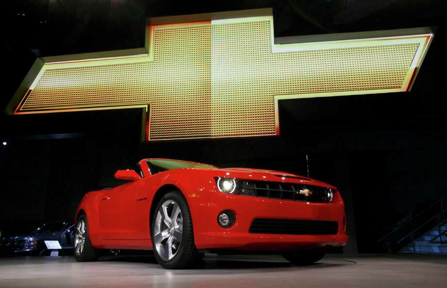 "In this Wednesday, Nov. 17, 2010, file photo, the 2011 Chevrolet Camaro convertible debuts at the Los Angeles Auto Show. General Motors is recalling nearly 512,000 Chevrolet Camaro muscle cars from the 2010 to 2014 model years. A driver's knee can bump the key and knock the switch out of the ""run"" position, causing an engine stall. (AP Photo/Reed Saxon, File) ORG XMIT: NY117 Photo: Reed Saxon / AP"