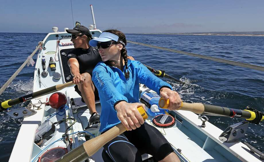 Sami Inkinen and wife Meredith Loring row during a morning workout on Monterey Bay, from which they will depart on their 2,400-mile journey to Hawaii. Photo: Michael Macor, The Chronicle
