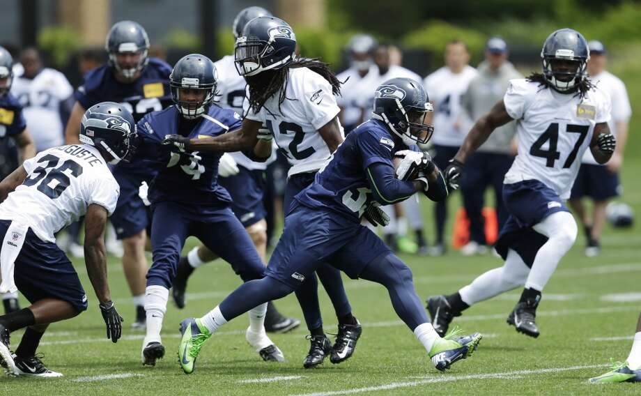 """3. Second-year players will be given a chance to make the leap…In running back Christine Michael, cornerback Tharold Simon and defensive tackles Jordan Hill and Jesse Williams, Seattle returns a handful of players from its 2013 draft class who barely played last season. The """"redshirts"""" will have a chance to prove their worth in 2014. Michael (above) was one of the highlights of OTAs, looking explosive and ready to challenge for the primary backup role behind Marshawn Lynch. Hill and Williams both saw lots of action in the D-line rotation, and Simon looked like a potential star in the making with his physicality and ball skills on Thursday — with a little coaching help from Richard Sherman. Photo: Ted S. Warren, Associated Press"""
