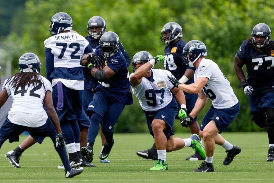 5. Position battles to watch: OffenseMichael certainly created a lot of buzz with his play during OTAs, but coaches gave just as much praise to third-year back Robert Turbin, who head coach Pete Carroll revealed had surgery to clean up a knee injury in the offseason. Turbin (with ball, above) is more polished than Michael and did look to have a little more burst than last season. It will be interesting to watch how the coaches use Turbin and Michael during training camp as they both jockey for position behind Marshawn Lynch.Meanwhile, the battle for the right tackle spot between Bowie and Britt might not be settled until late in the preseason. Photo: Jordan Stead, Seattlepi.com