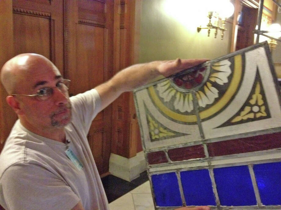 Glenn Shalan, a stained glass conservationist shows one of the hundreds of panels taken from atrium roofs in Connecticut Capitol in Hartford, Conn.  It's about the halfway point in a $700,000 restoration and conservation project that began more than six years ago. Photo: Ken Dixon / Connecticut Post