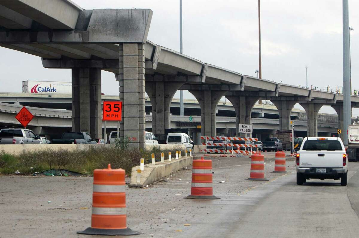 Traffic slows down along Highway 290 as road construction takes place Friday, Dec. 20, 2013, in Houston. (Cody Duty / Houston Chronicle)