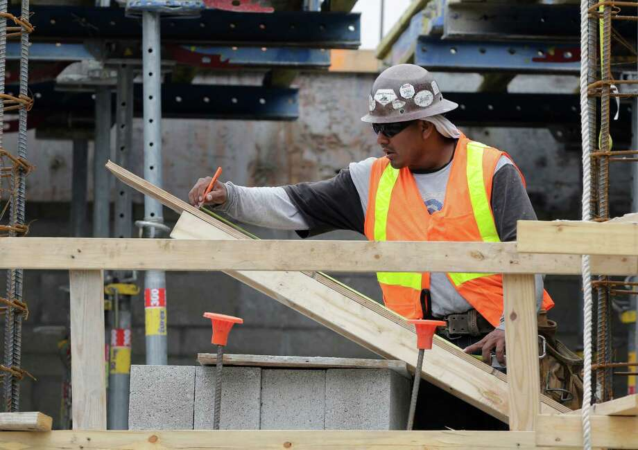 Pay adviser Buck Consultants foresees raises for all construction workers averaging more than 3 percent for a second straight year. Photo: Lynne Sladky, STF / AP