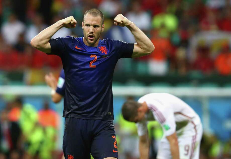 SALVADOR, BRAZIL - JUNE 13:  Ron Vlaar of the Netherlands gestures to the crowd after defeating Spain 5-1 during the 2014 FIFA World Cup Brazil Group B match between Spain and Netherlands at Arena Fonte Nova on June 13, 2014 in Salvador, Brazil.  (Photo by Quinn Rooney/Getty Images) ORG XMIT: 491932433 Photo: Quinn Rooney / 2014 Getty Images