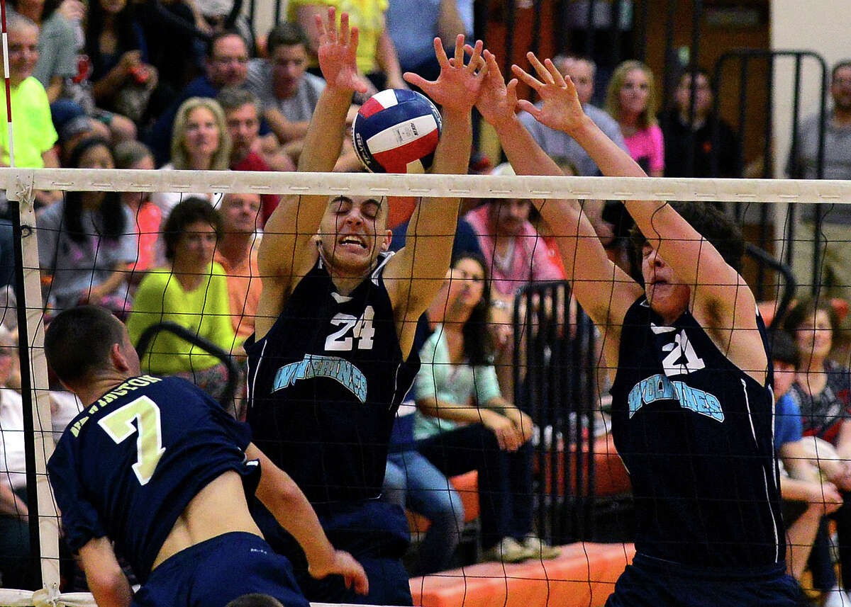 Oxford's Matt Dogali and Nick Orban, right, fail to stop a spike by Newington's Jordan Aprea, during Class M Volleybal Championship in Shelton, Conn. on Friday June 13, 2014.