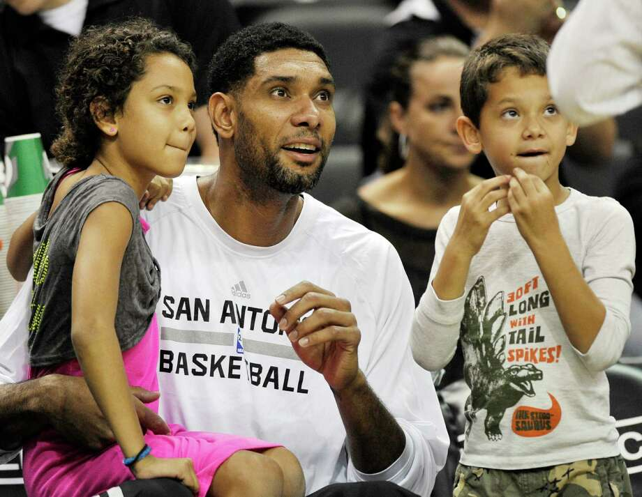 The Spurs are a very family oriented team, and many of the players are dads. Here are some current and former Spurs players and their kids (or fathers), to help celebrate the Silver-and-Black on Father's Day.PHOTO: Tim Duncan sits on the Spurs bench with his daughter, Sydney (left), and son, Draven, before an NBA preseason basketball game against the Phoenix Suns on Oct. 13, 2013, in San Antonio. Photo: Darren Abate, Associated Press / FR115 AP