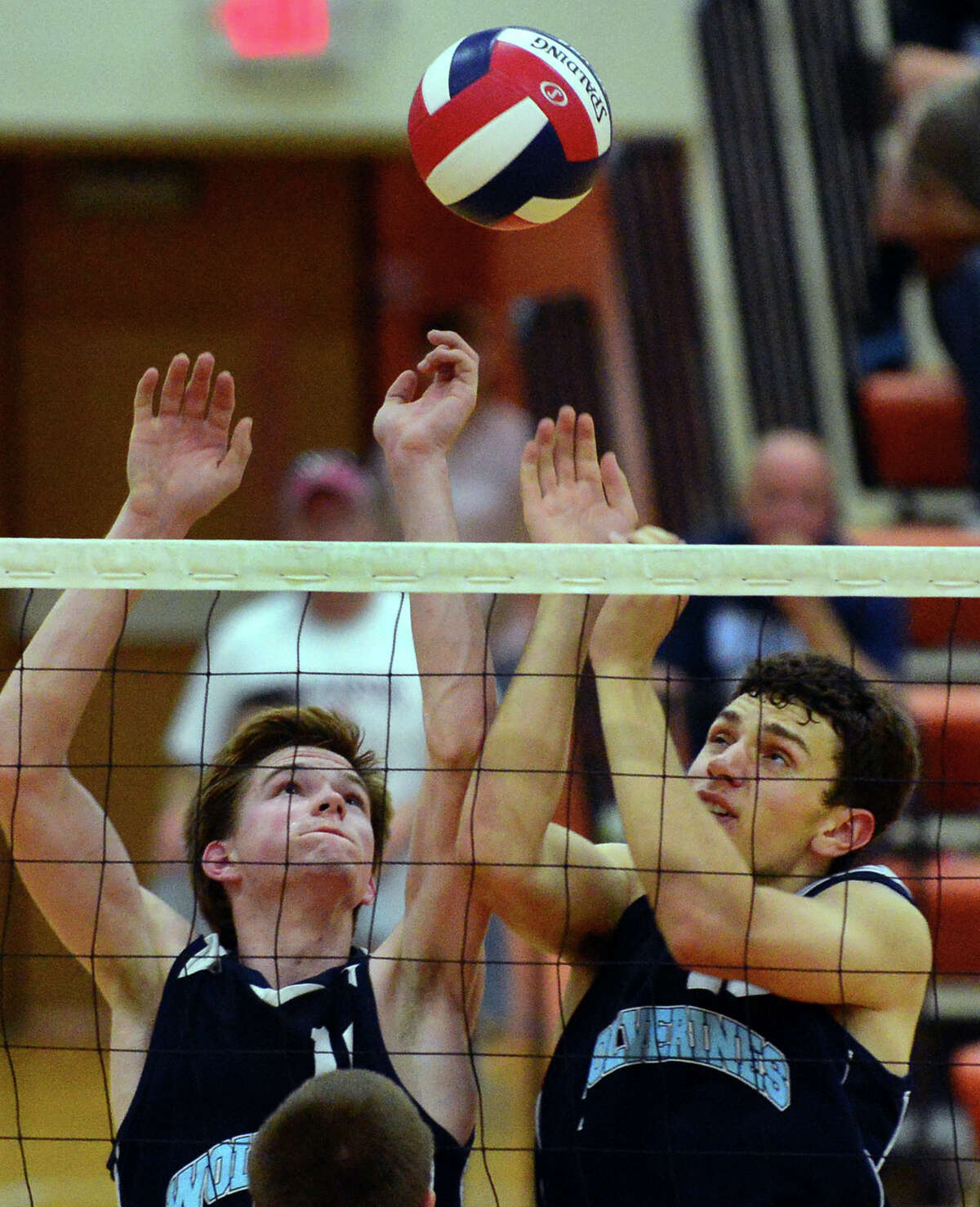 Oxford's Nathan Seibert, left, and teammate Eric Jensen, try to block a Newington shot, during Class M Volleybal Championship action in Shelton, Conn. on Friday June 13, 2014.