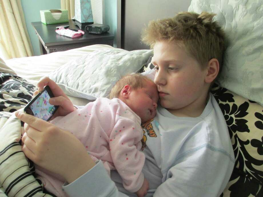 Miracles do happen Jordan Quay, 11, is his new baby sister London Rose?s best sitter. Lori and Joel Quay of Altamont are thrilled to welcome her into their family along with big brother Justin, age 17.  (Joel Quay, Guilderland)