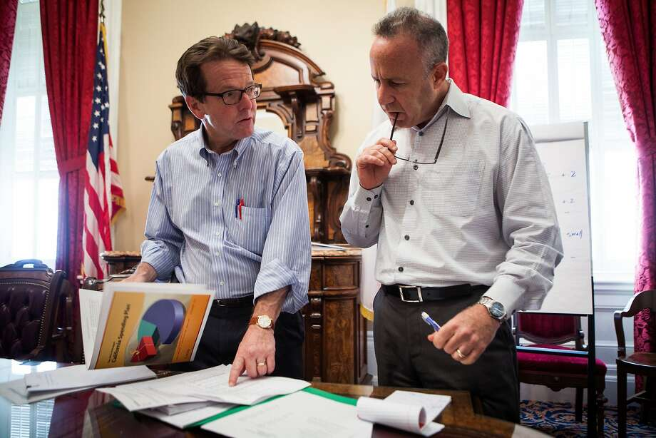 State Senate president pro tem Darrell Steinberg, right, goes over the state budget with senate finance director Craig Cornett, left in his State Capitol office in Sacramento, California, June 13, 2014. Photo: Max Whittaker/Prime, Special To The Chronicle