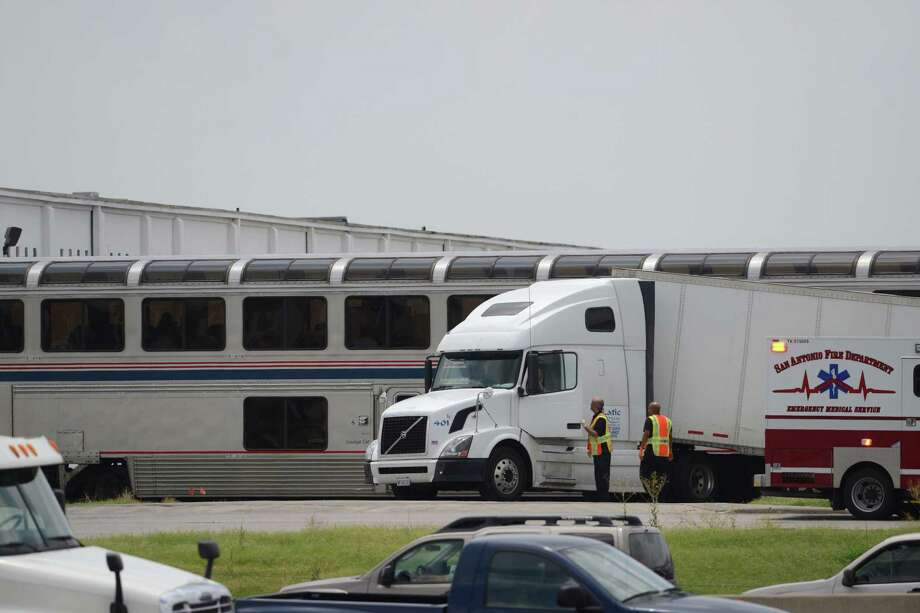 An 18-wheeler rests where it stopped after being hit by an Amtrak passenger train near the intersection of Interstate 35 and Walzem Road in San Antonio on Friday, June 13, 2014. Photo: Billy Calzada, San Antonio Express-News /  San Antonio Express-News
