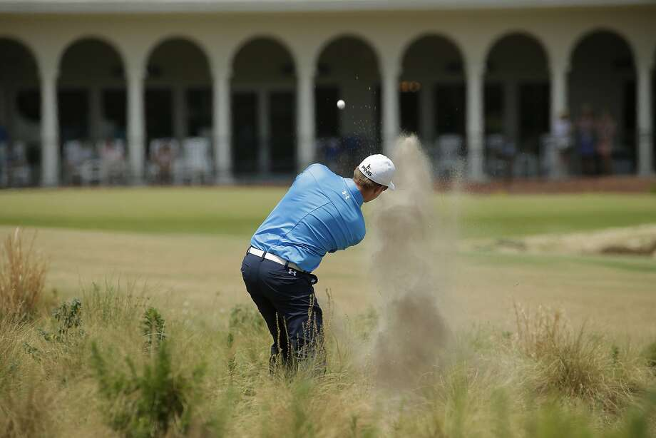 Hunter Mahan hits from the waste area on the 18th hole during a practice round for the U.S. Open golf tournament in Pinehurst, N.C., Wednesday, June 11, 2014. The tournament starts Thursday. (AP Photo/Charlie Riedel) Photo: Charlie Riedel, Associated Press