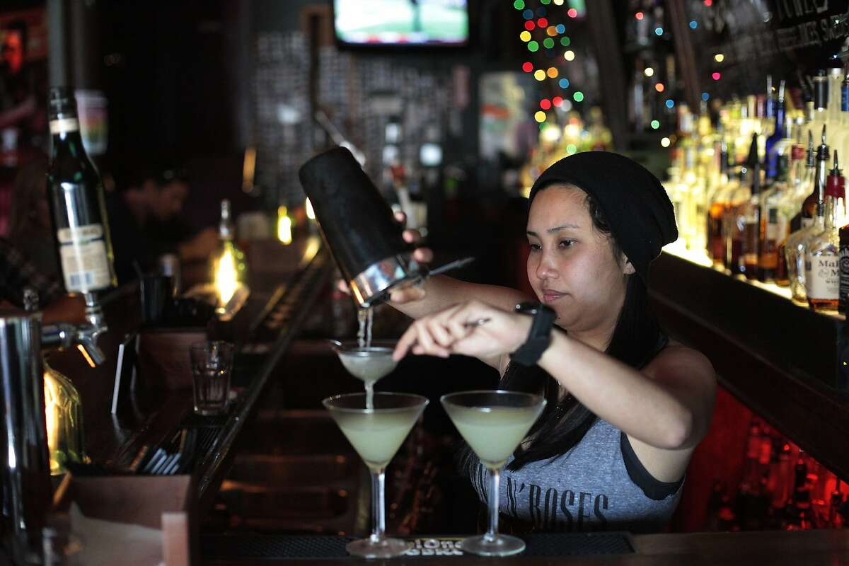 Ivana Tan prepares drinks for customers at Tonic in San Francisco, Calif. on Thursday, June 12, 2014. San Francisco's minimum wage does not include a tip credit will get a raise whereas kitchen workers will not.