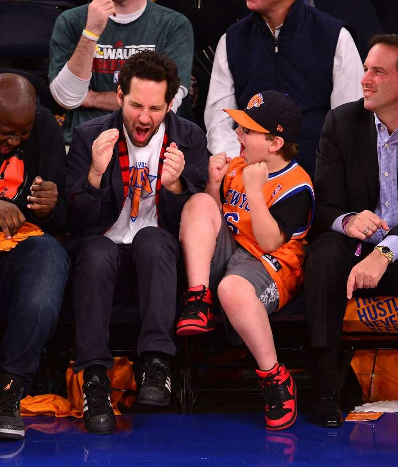 Paul Rudd is dad to to two kids, a son and daughter. Here, he and his son root on the Knicks. Photo: James Devaney, FilmMagic