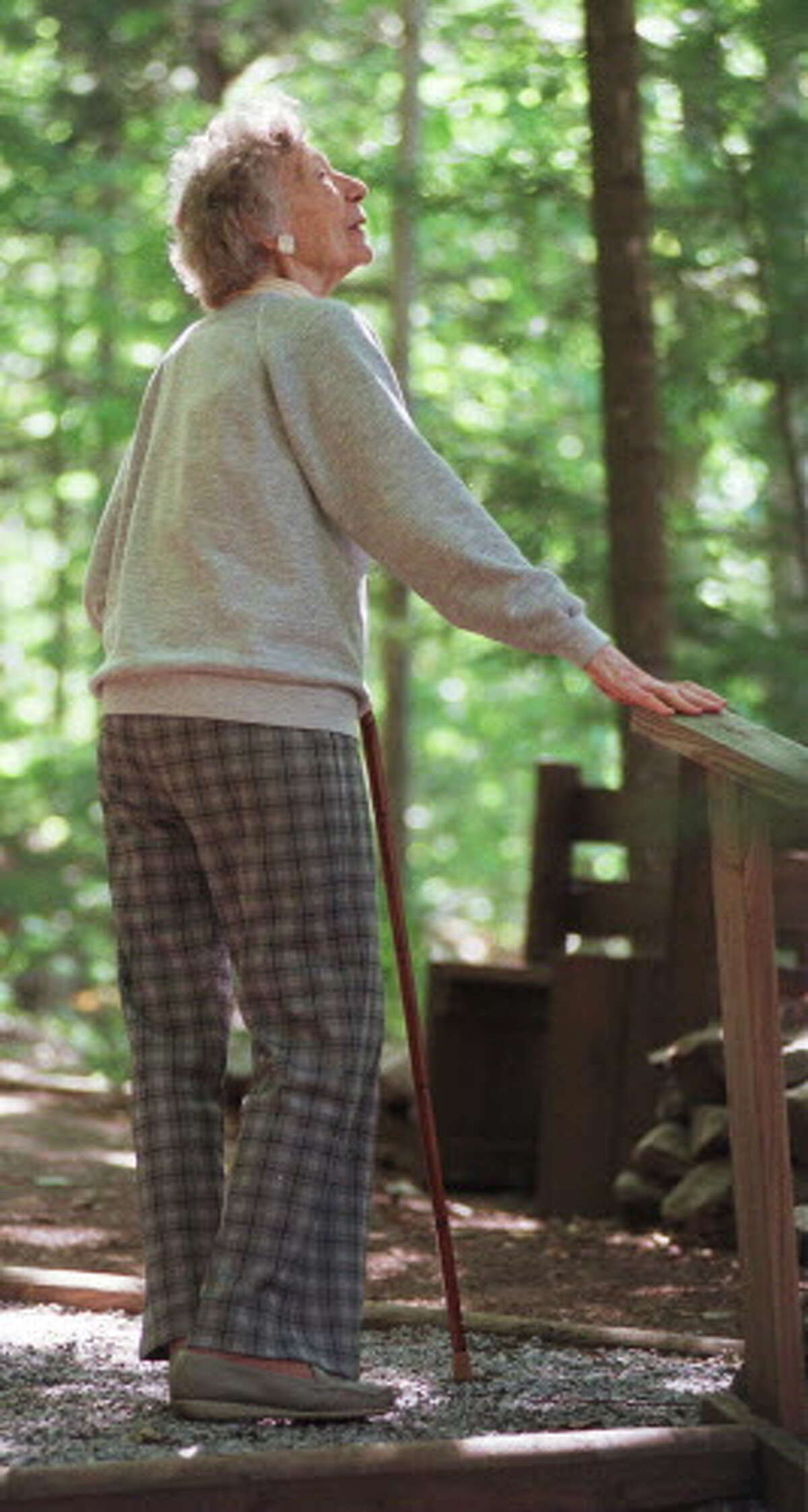 Grace Hudowalski walks on her Adirondacks property in 1997. She was one of the original 46ers. (Skip Dickstein/Times Union archive)