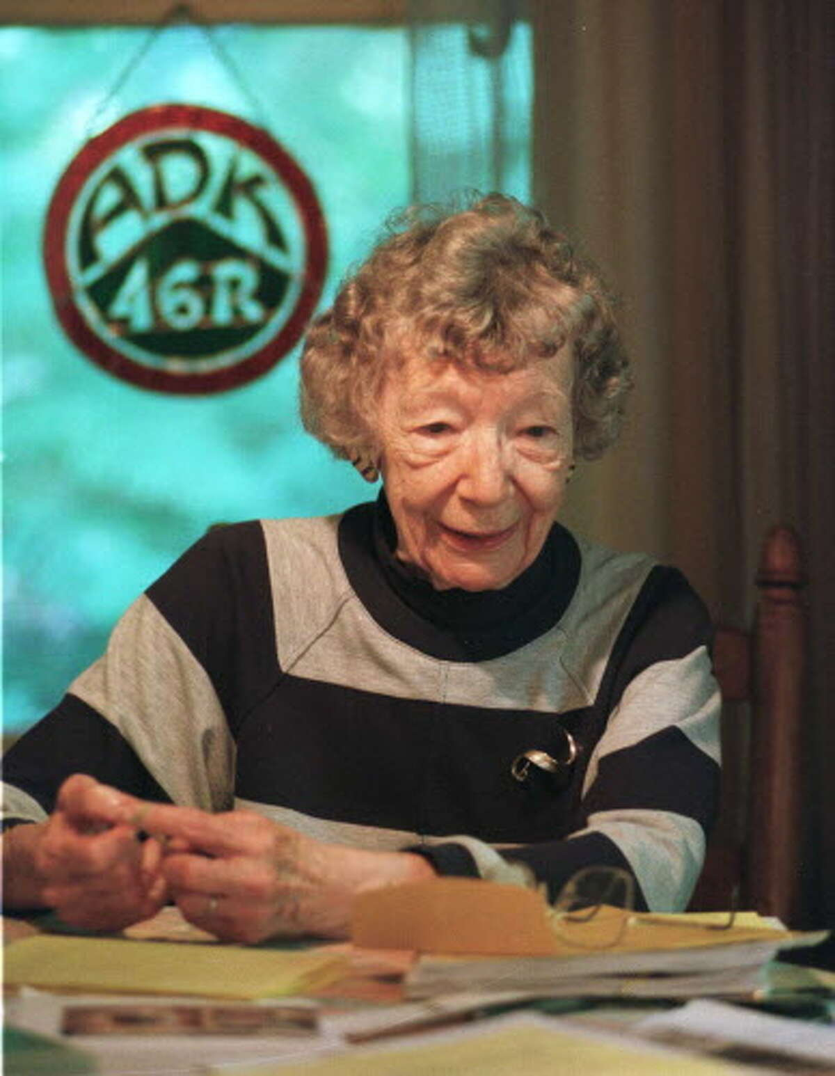 Grace Hudowalski at the kitchen table of her Adirondacks home in 1997. She was one of the original 46ers. (Skip Dickstein/Times Union archive)
