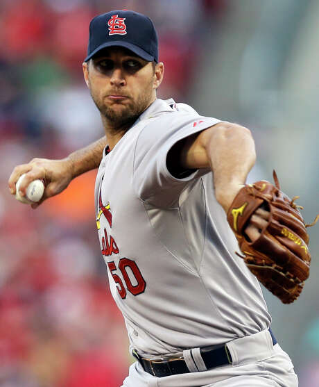 St. Louis Cardinals starting pitcher Adam Wainwright throws against the Cincinnati Reds in the first inning of a baseball game, Sunday, May 25, 2014, in Cincinnati. (AP Photo/Al Behrman) Photo: Al Behrman, STF / AP