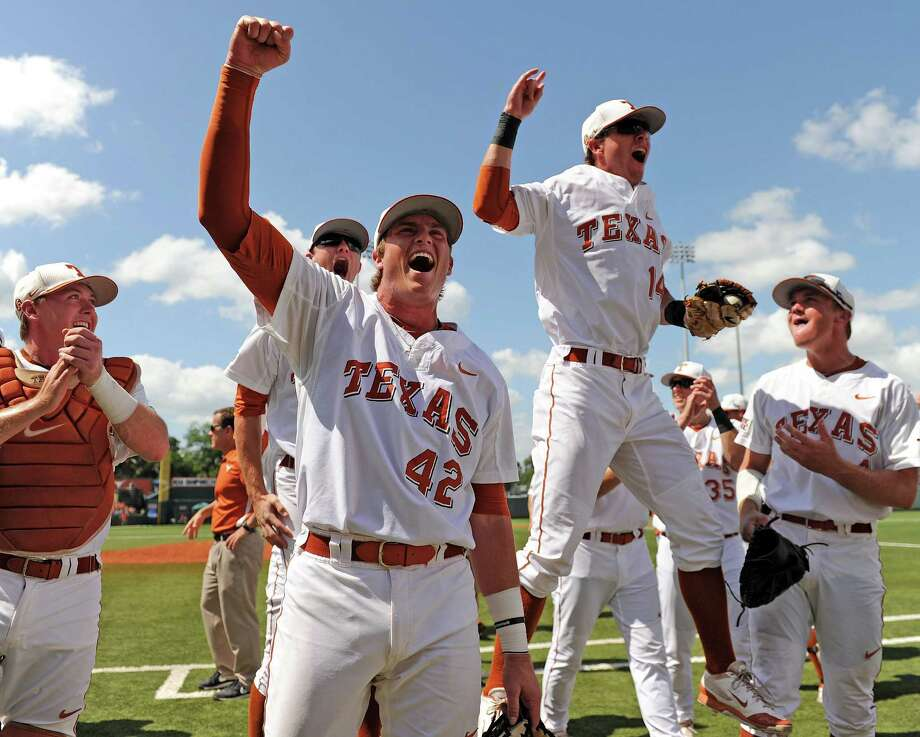 Kacy Clemens (42) and his teammates were sky-high after winning their super regional last weekend to send Texas to the College World Series for the 35th time. Photo: Eric Christian Smith, Freelance