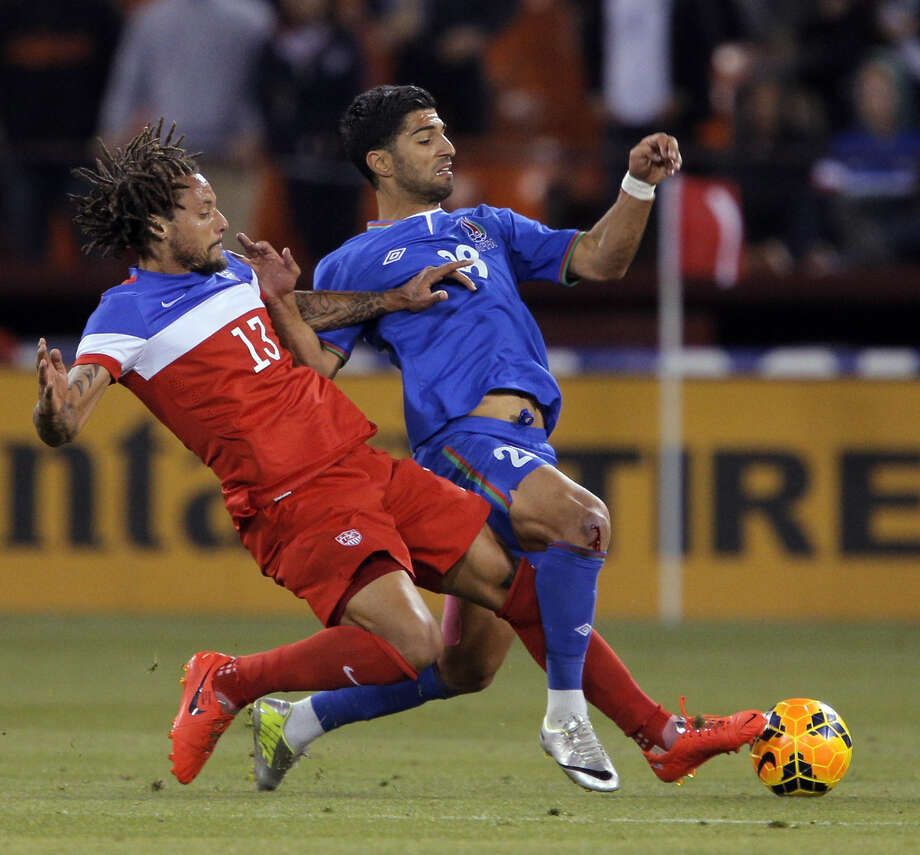 U.S. midfielder Jermaine Jones (13) and Pardis Fardjad-Azad battle in a friendly with Azerbaijan. The U.S. men will have to be careful with their tackles in Brazil. Photo: Carlos Avila Gonzalez, Staff Photographer / ONLINE_YES