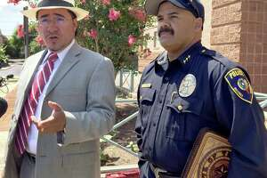 Attorney Mark Anthony Sanchez (left) is calling for the immediate reinstatement of Balcones Heights Police Chief Henry Dominguez.