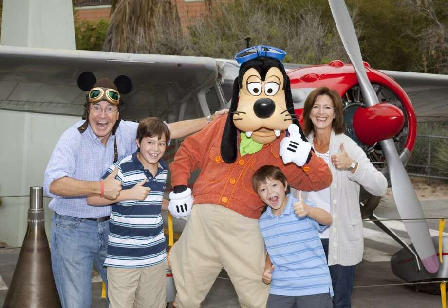 "New ""Late Show"" host Stephen Colbert clowns around with his sons, wife and Goofy at Disney. He's also dad to a daughter. Photo: Handout, Getty Images"