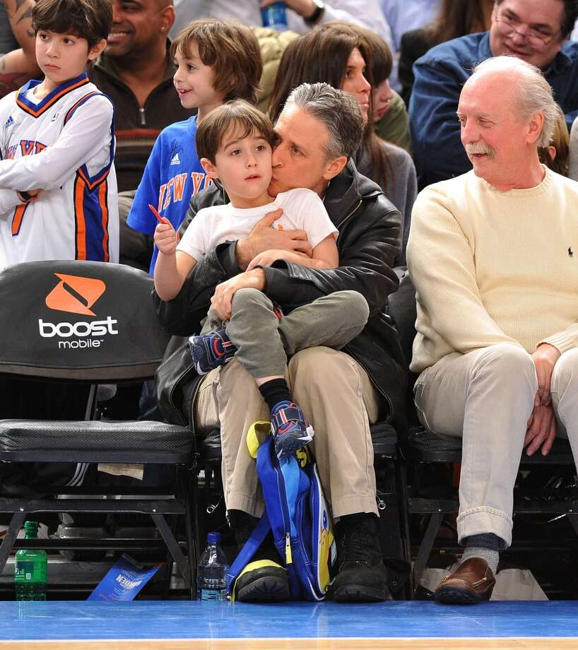 "Aww, sweet moment. ""The Daily Show"" host Jon Stewart smooches his son at a Knicks game. He also has a daughter. Photo: James Devaney, WireImage"
