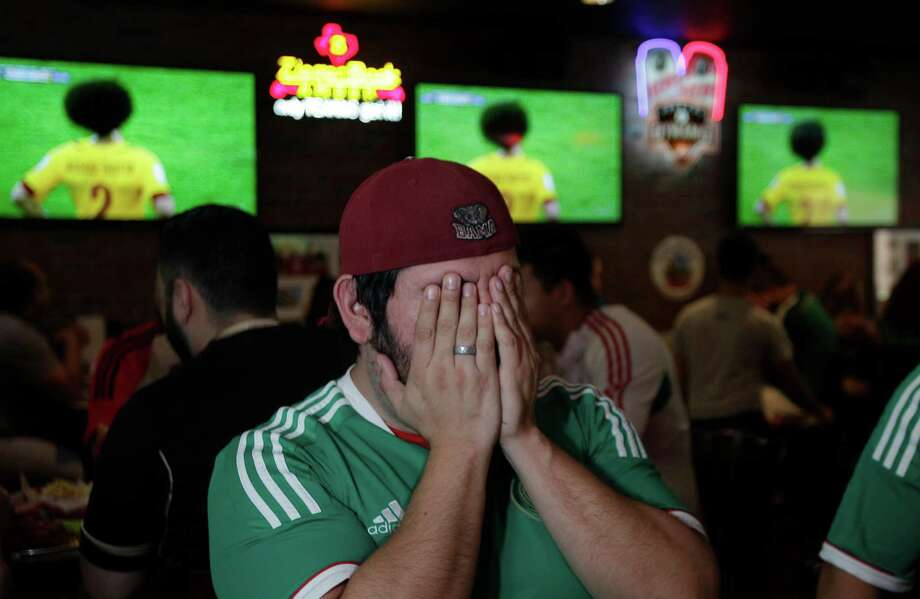 Tony Landero upset over a missed attempt to score in the second half of the World Cup's Mexico vs Cameroon game during a Dynamo viewing party at Pluckers Wing Bar on June 13, 2014, in Houston, Tx. Photo: Mayra Beltran, Houston Chronicle / © 2014 Houston Chronicle