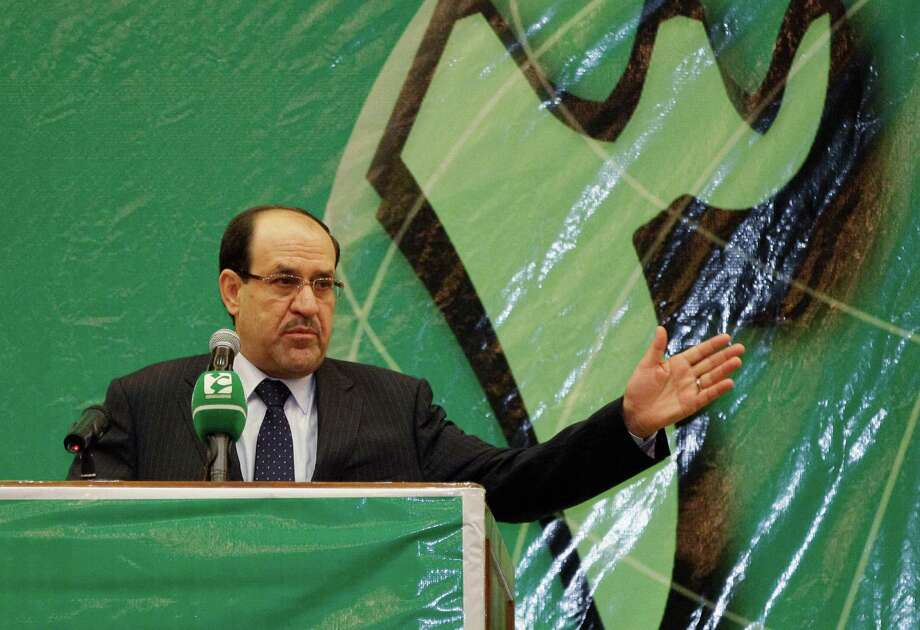 FILE - In this file photo taken Saturday, July 27, 2013, Iraqi Prime Minister Nouri al-Maliki speaks during the 32nd anniversary of the foundation of the Badr Organization in Baghdad, Iraq. The disastrous loss of a large swath of the north and two cities to Islamic militants is threatening to cost Iraq's prime minister, Nouri al-Maliki, a third term in office as his longtime Shiite backers turn against him and seek an alternative. (AP Photo/Karim Kadim, File) ORG XMIT: CAI116 Photo: Karim Kadim / AP