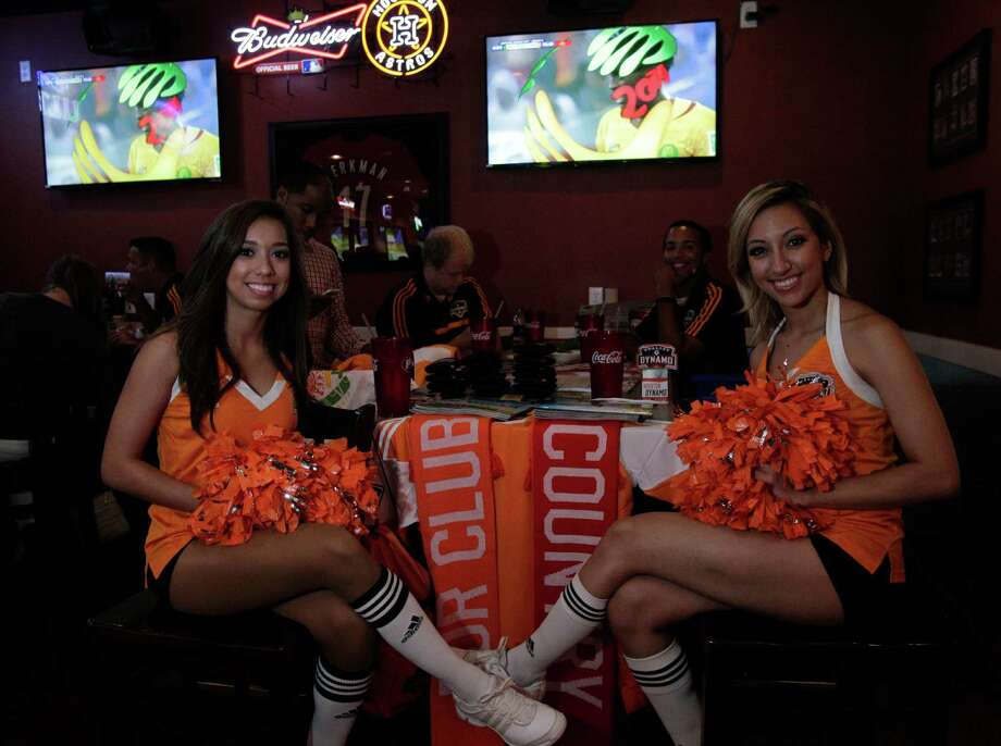 Dynamo Girls attend the viewing party for the World Cup Mexico vs Cameroon game at Pluckers Wing Bar on June 13, 2014, in Houston, Tx. Photo: Mayra Beltran, Houston Chronicle / © 2014 Houston Chronicle
