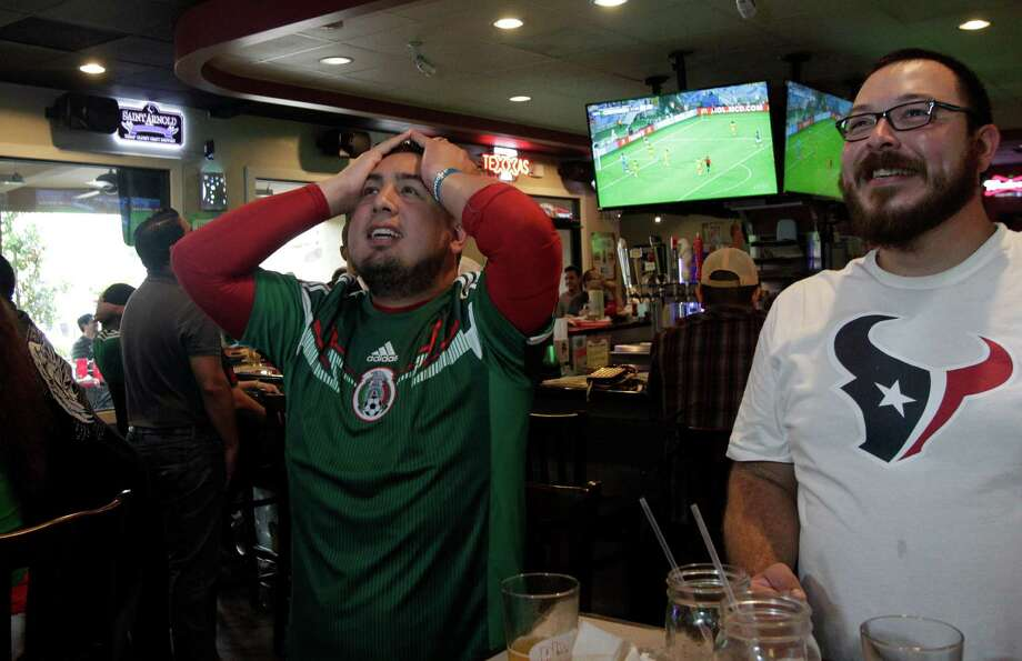 Erick Juarez and Alex Moreno react to Cameroon's close call to score against Mexico in the second half of the World Cup's Mexico vs Cameroon game during a Dynamo viewing party at Pluckers Wing Bar on June 13, 2014, in Houston, Tx. Photo: Mayra Beltran, Houston Chronicle / © 2014 Houston Chronicle
