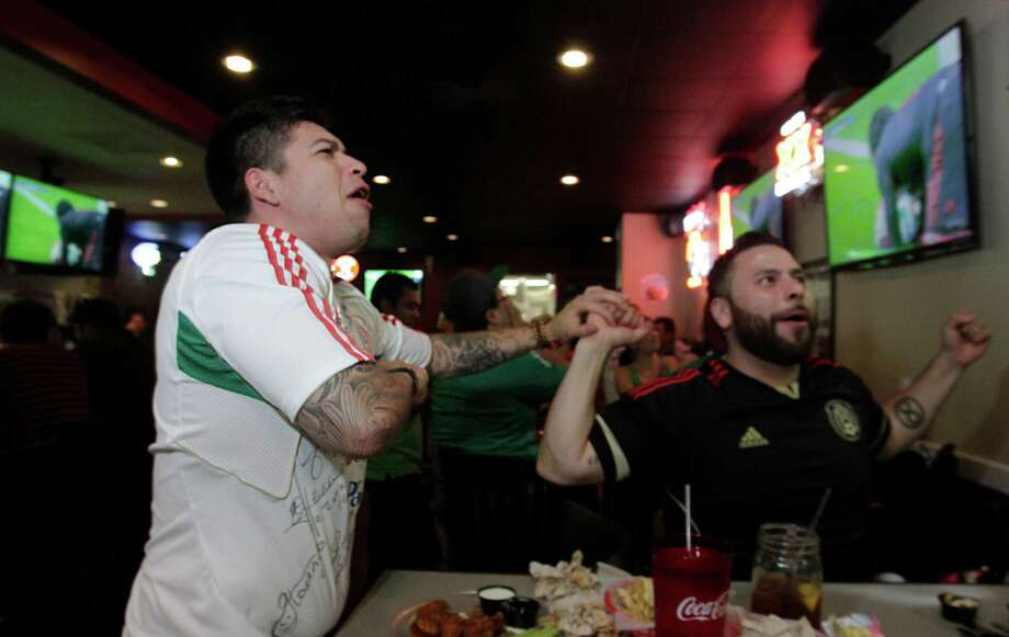 Oscar Servin celebrate Guillermo Ochoa's saved preventing Cameroon to score against Mexico in the second half of the World Cup's Mexico vs Cameroon game during a Dynamo viewing party at Pluckers Wing Bar on June 13, 2014, in Houston, Tx. Photo: Mayra Beltran, Houston Chronicle / © 2014 Houston Chronicle
