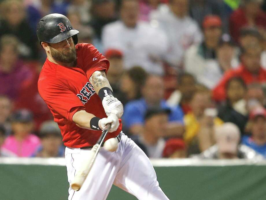 BOSTON, MA - JUNE 13:  Mike Napoli #12 of the Boston Red Sox doubles in two runs against the Cleveland Indians in the third inning at Fenway Park on June 13, 2014 in Boston, Massachusetts.  (Photo by Jim Rogash/Getty Images) ORG XMIT: 477584871 Photo: Jim Rogash / 2014 Getty Images