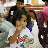 One-year-old Danny Hernandez, Jr. waits with family to board a bus for Long Island, New York at the terminal in McAllen, Texas, Wednesday, June 11, 2014. The family is from Zihualtepec, Honduras. With the child are from left, brother, Patrick, 6, mother, Jamileth Perez, 35 and brother, Leonel Alberto, 14. Relatives in the states purchased their tickets. A wave of Central American adults with children and unaccompanied minors has overwhelmed U.S. Immigration and Customs detention centers. Immigration officials release some of them on their own recognizance after undergoing processing.