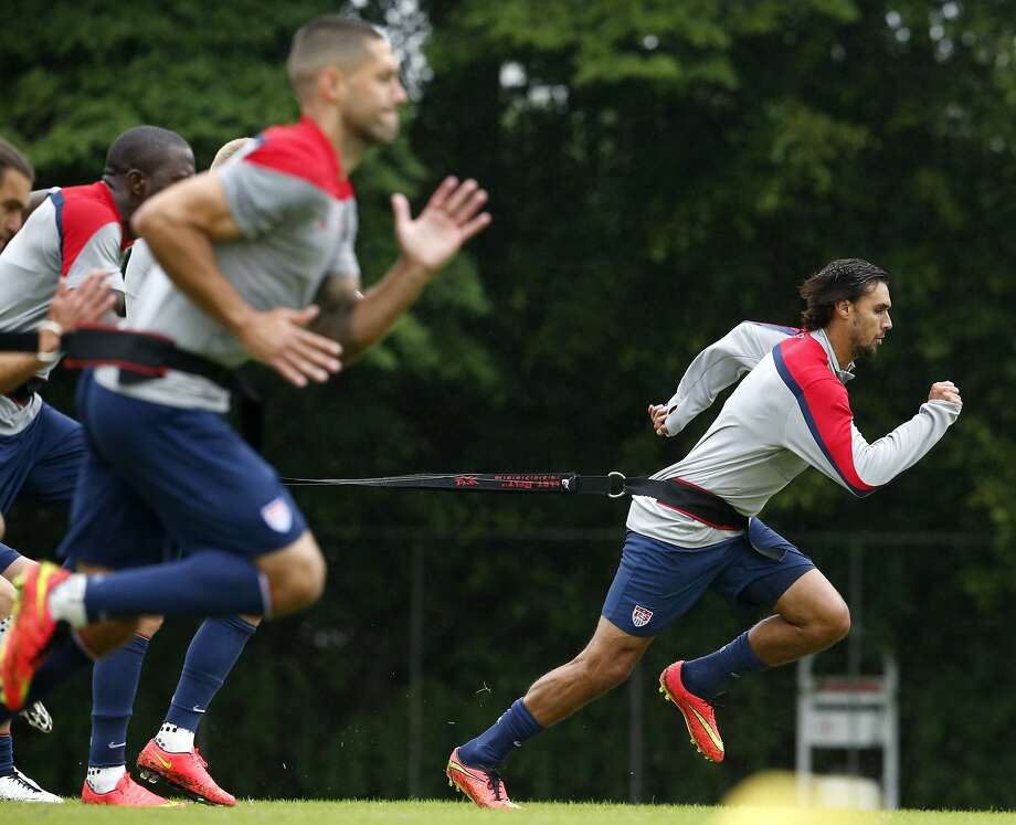 Chris Wondolowski (front) runs resistance exercises with the U.S. men's national team. Photo: Julio Cortez, Associated Press